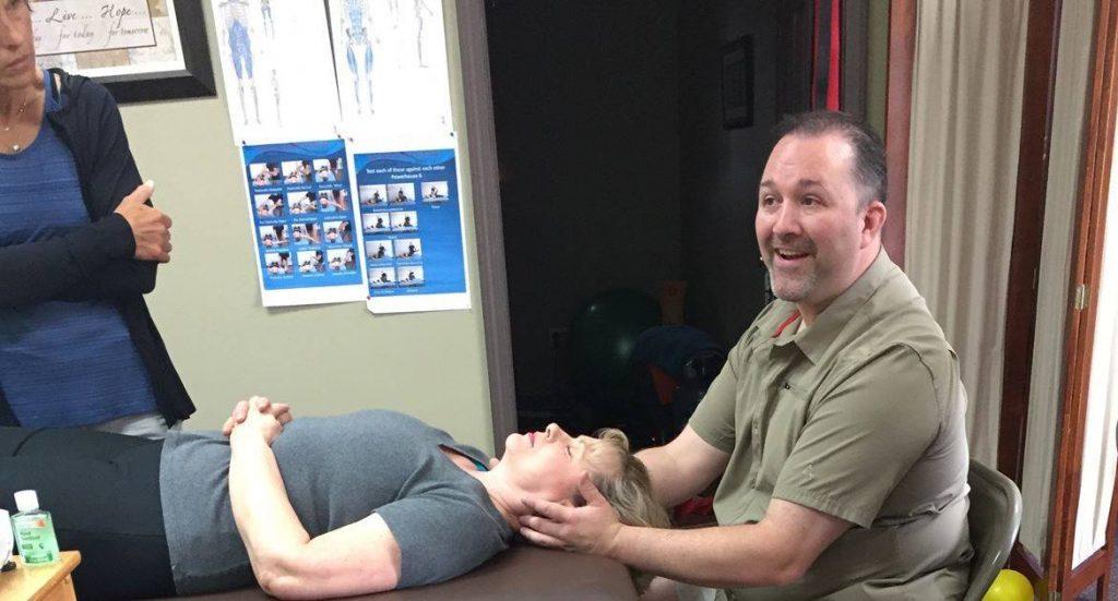 massage therapist teaches class